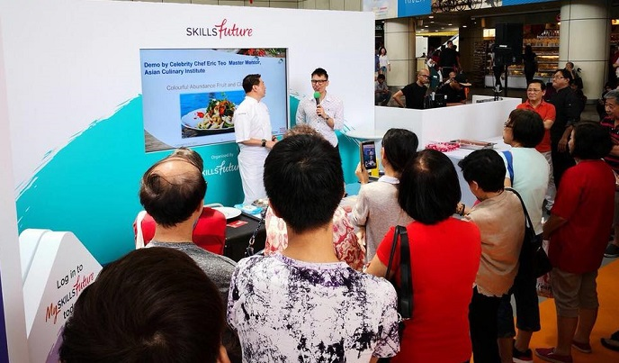 Emcee Lester with celebrity chef Eric Teo